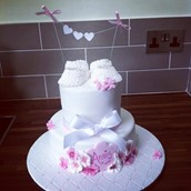 Floral booties christening cake - licky lips cakes liverpool